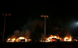 A row of cars burn at a used-car lot during a demonstration on Nov. 25, 2014, in Ferguson, Mo.Justin Sullivan/Getty Images