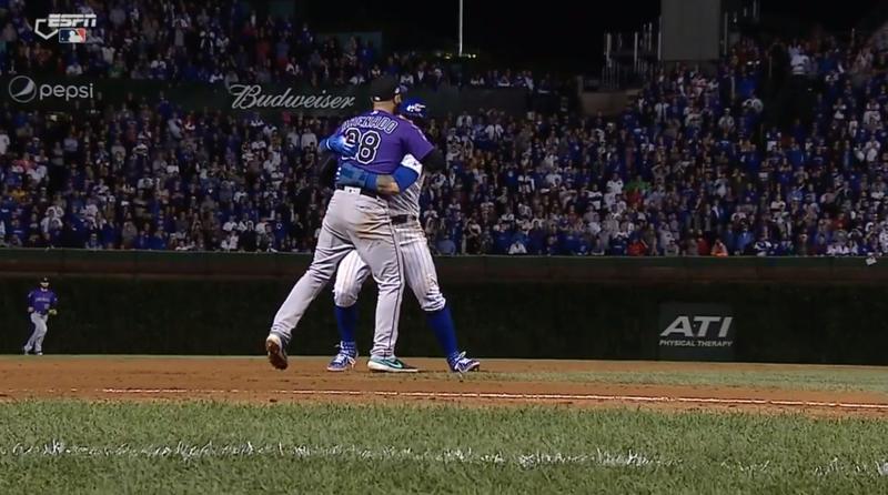 Illustration for article titled Javier Baez And Nolan Arenado Share Warm Hug During Live Baseball Play