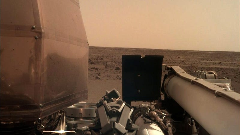 The first released photo taken by NASA's Insight lander after the removal of its lens cover.