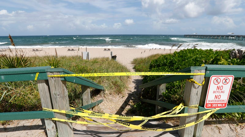 An access point to a beach closed off in Palm Beach County due to red tide on October 2.