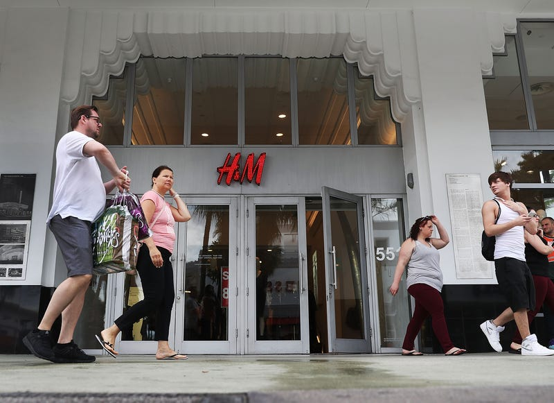 People walk past an H&M clothing store on Jan. 9, 2018, in Miami Beach, Fla. (Joe Raedle/Getty Images)
