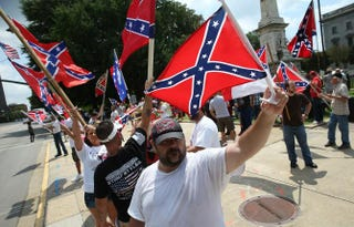 Demonstrators protest at the South Carolina Statehouse June 27, 2015, in Columbia, S.C., calling for the Confederate flag to remain on Statehouse grounds.Win McNamee/Getty Images