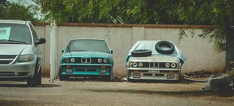 Two BMW E30s rusting away. Photo Credit: Kristian Sharon