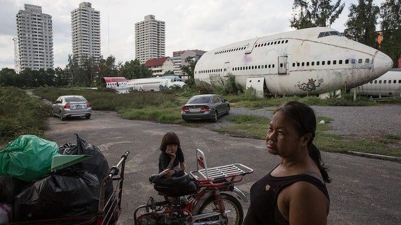 Image result for Dismantling planes serve as makeshift home in Bangkok