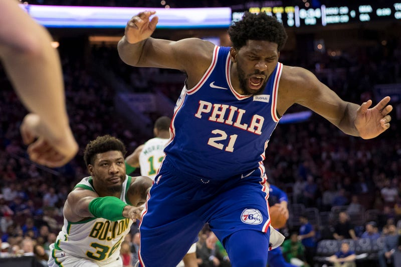 Illustration for article titled I Can't Stop Looking At This Photo Of Marcus Smart Nonchalantly Shoving Joel Embiid