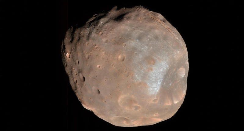 Illustration for article titled Marte destruirá a Fobos, su luna más grande, dentro de 30 millones de años