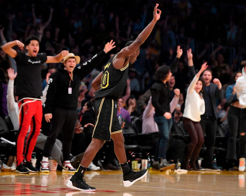 Los Angeles Lakers guard Andre Ingram celebrates after making a 3-point shot during the second half of the team's NBA basketball game against the Houston Rockets on April 10, 2018, in Los Angeles.