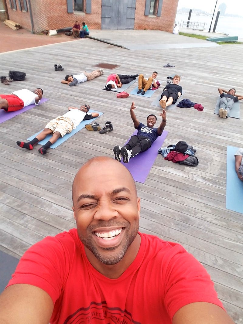 Changa Bell (front), founder of the Black Male Yoga Initiative, with studentsCourtesy of Changa Bell
