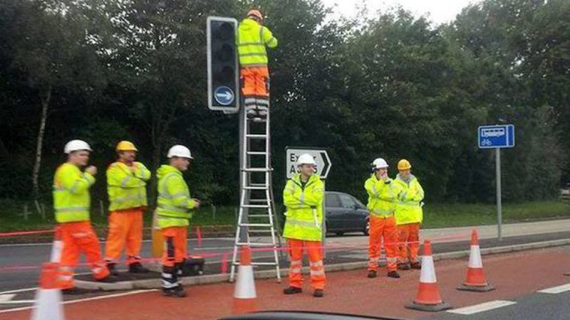 How Many Road Workers Does It Take To Change A Traffic Light?