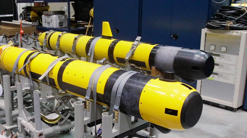 A pair of unmanned underwater vehicles in a lab at the Naval Undersea War Center