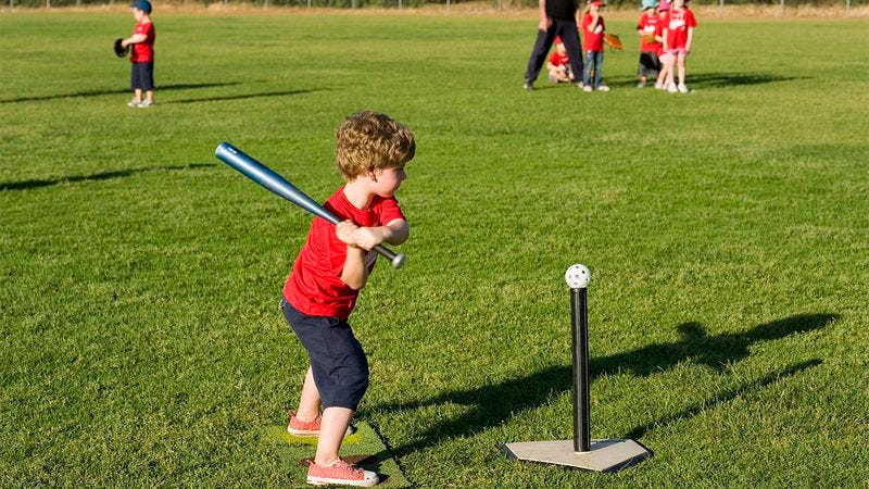 A kid playing t-ball.