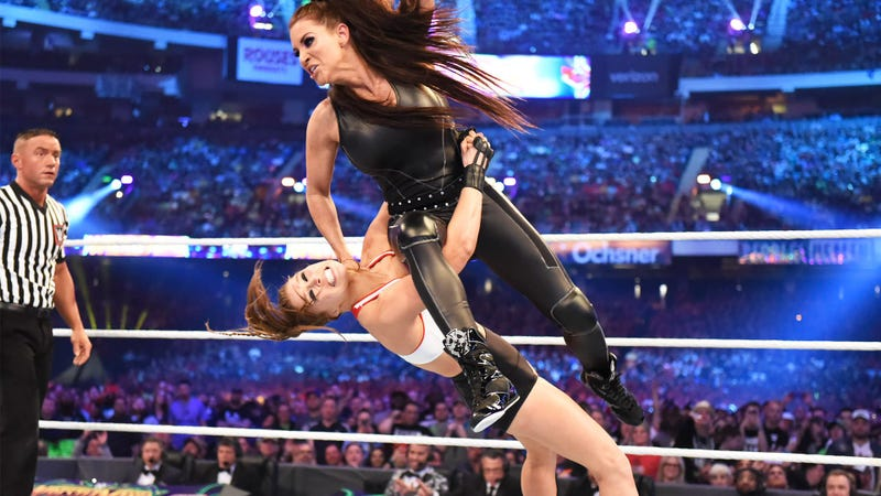 Ronda Rousey, one of the two women arguably most responsible for WWE's current mainstream acceptance, suplexes the other, Stephanie McMahon, at WrestleMania 34 in April.