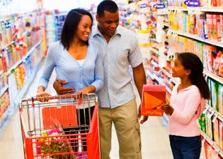A family uses their spending power to shop. (Thinkstock)