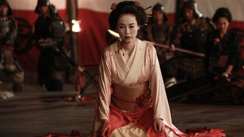 Akane the Geisha causes some heads to roll—well, more like flop a bit—thanks to some practical FX magic.