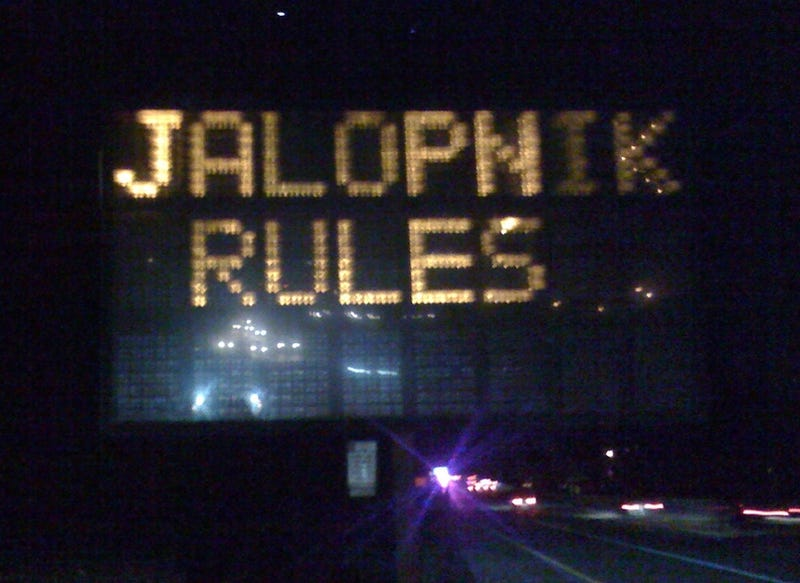 Illustration for article titled Jalopnik-Hacked Road Sign: We're All Going To Jail Now