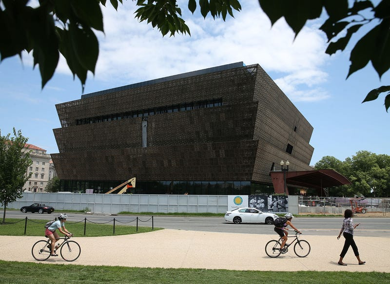 Tourists walk past the Smithsonian National Museum of African American History and Culture on July 16, 2015, in Washington, D.C. The museum is set to open September 2016.Mark Wilson/Getty Images