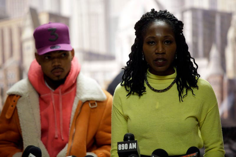 Chance the Rapper listens to Chicago mayoral candidate Amara Enyia speak during a news conference at City Hall on Tuesday, October 16, 2018 in Chicago, Illinois. Chance the Rapper announced his endorsement for Enyia and said she is the best candidate for Chicago.