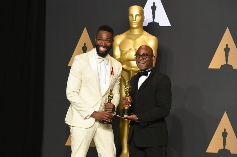 Actor Tarell Alvin McCraney and director Barry Jenkins, winners of the award for best adapted screenplay for Moonlight, pose in the press room at the Oscars on Feb. 26, 2017, in Los Angeles.