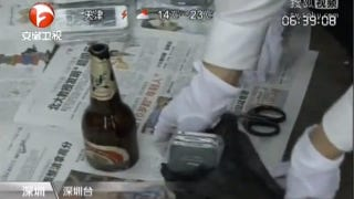 Illustration for article titled Smuggling iPhones with Empty Beer Bottles Won't Get You Drunk