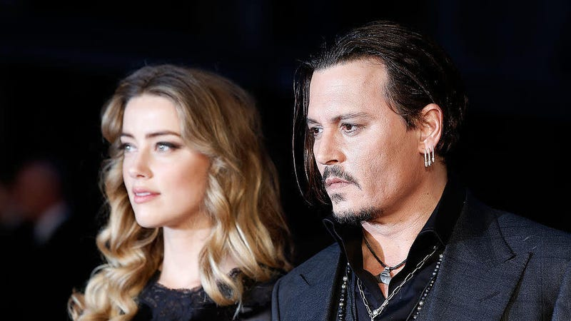 Illustration for article titled Johnny Depp, Accused of Domestic Abuse, Claims Amber Heard 'Painted On' Her Bruises