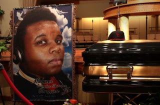 The casket of Michael Brown sits inside Friendly Temple Missionary Baptist Church awaiting the start of his funeral on Aug. 25, 2014, in St. Louis.Robert Cohen-Pool/Getty Images