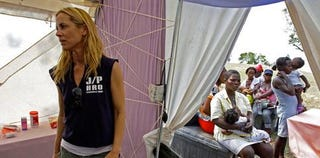 Maria Bello works with women in Haiti. (Google)