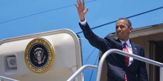 President Barack Obama boards Air Force One during a visit to Latin America. (Mandel Ngan/AFP/Getty Images)
