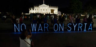 Demonstrators protest against U.S. intervention in Syria in front of the White House. (Nicholas Kamm/Getty Images)