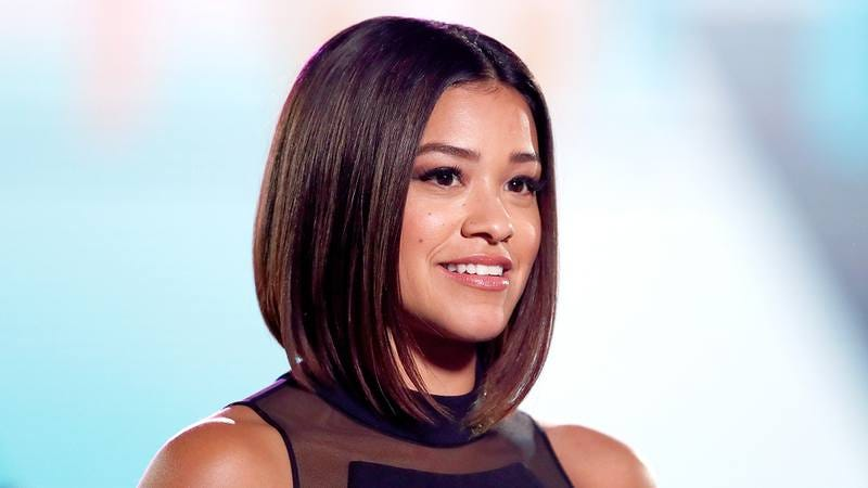 Illustration for article titled 'The New Carmen Sandiego Will Spend A Few Years With Her Ass Stuck In Old Faithful': 5 Questions With Gina Rodriguez
