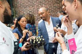 Guests enjoy hors d'oeuvres at a Taste of the Iconoclast Dinner event.
