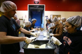Volunteers pack bags of rice at the San Francisco Food Bank in California.Justin Sullivan/Getty Images