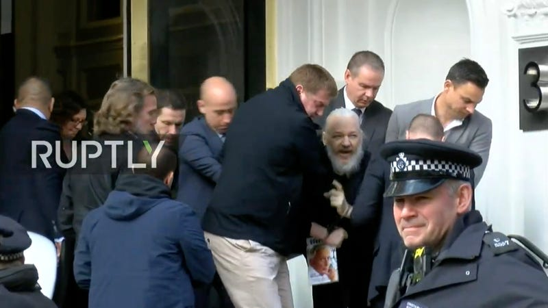 Julian Assange being dragged out of the Ecuadorian embassy in London, England by British Police on Thursday morning