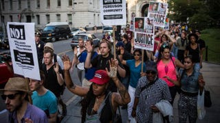 Protesters hold a rally on Aug. 18, 2014, in New York City in solidarity with the people in Ferguson, Mo., protesting the death of Michael Brown.Andrew Burton/Getty Images