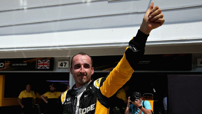 Kubica, displaying his arm. Photo credit: Getty Images