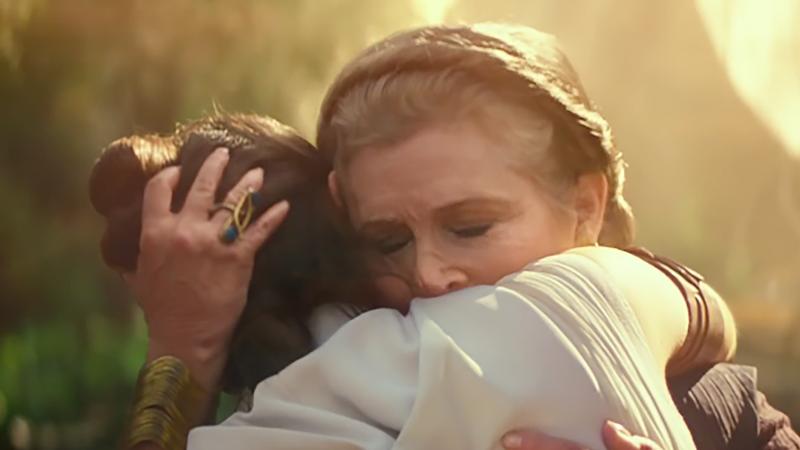 Rey and Leia hug.