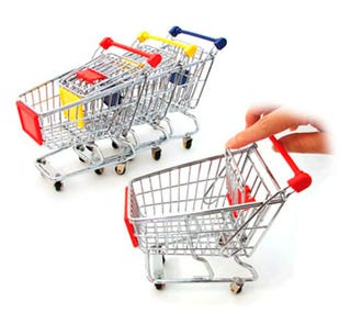 Illustration for article titled Miniature Shopping Carts Let You Play Bag Lady Barbie