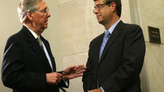 Senate Minority Leader Mitch McConnell (R-Ky.) talks to Rep. Lee Terry (R-Neb.) prior to a news conference Sept. 19, 2013, on Capitol Hill in Washington, D.C.Alex Wong/Getty Images
