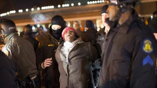 Police arrest a demonstrator protesting the shooting death of 18-year-old Michael Brown outside the Ferguson, Mo., police station on Nov. 20, 2014. At least three people were arrested during the protest.Scott Olson/Getty Images