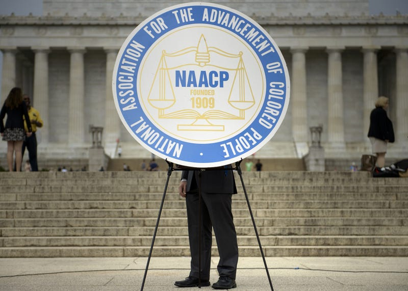 A sign with the logo of the NAACP is seen during a rally at the Lincoln Memorial on the National Mall in Washington, D.C., on June 15, 2015, for an event focused on voting rights and civil rights. BRENDAN SMIALOWSKI/AFP/Getty Images