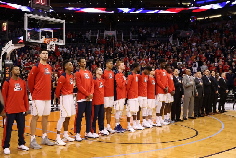 The Arizona Wildcats stand for the national anthem before the college basketball game against the Texas A&M Aggies at Talking Stick Resort Arena on Dec. 5, 2017, in Phoenix. (Christian Petersen/Getty Images)