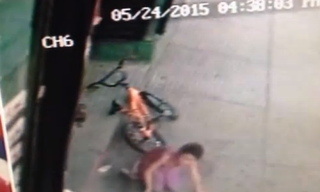 Divan Silva on the ground after being hit by a stray bullet near a barbershopABCNews/Surveillance Footage