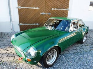 Illustration for article titled My son sold his S2000CR, now hes swapping a V6 into one of these MGB GTs