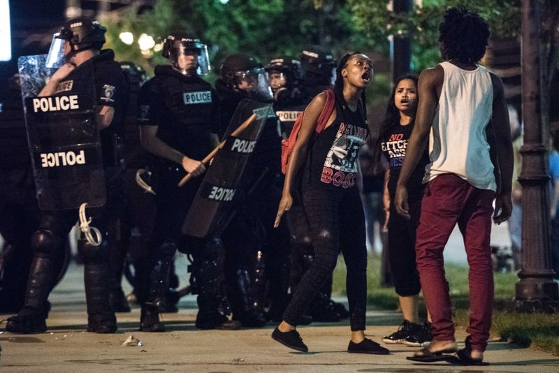 Demonstrators argue among themselves during protests Sept. 22, 2016, in downtown Charlotte, N.C., in the wake of the fatal police shooting of Keith Lamont Scott. Sean Rayford/Getty Images
