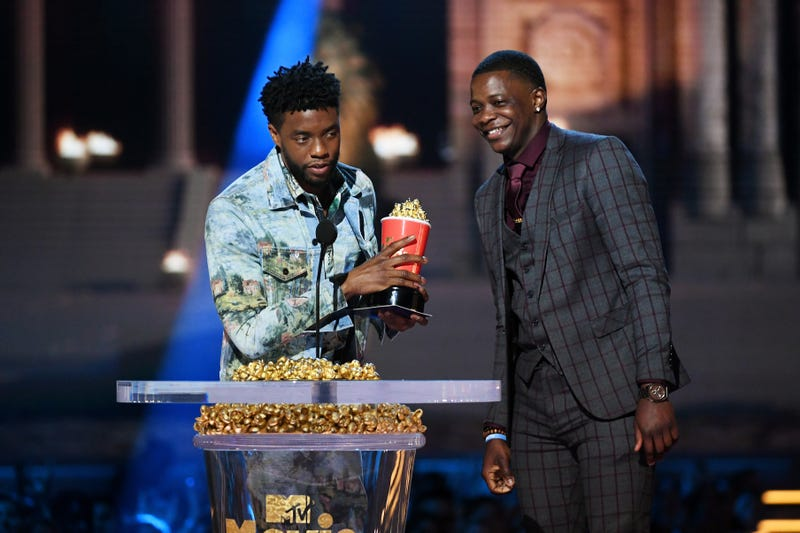Chadwick Boseman, winner of the Best Hero award for Black Panther, presents his trophy to James Shaw Jr. onstage during the 2018 MTV Movie & TV Awards at Barker Hangar on June 16, 2018, in Santa Monica, Calif.