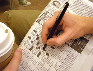 Illustration for article titled Commuter Playing Some Sort Of Alphabet Sudoku