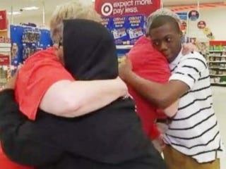 Yasir Moore (right) and his mother, Najirah Parrish, returned to the North Carolina Target store where employees helped her son prepare for a job interview to thank the employees.  WHAS11 screenshot