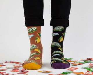 Illustration for article titled Behold. You Can Now Warm Your Feet With Taco Bell Socks, I Guess