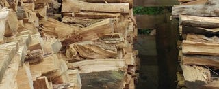 Illustration for article titled Can You Find the Cat Taking a Nap on This Pile of Wood?