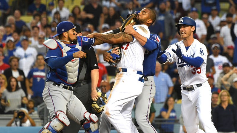 Illustration for article titled Punches Nearly Thrown In Near Brawl After Matt Kemp Trucks Robinson Chirinos At The Plate