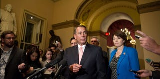 John Boehner speaks to the press. (Nicholas Kamm/AFP)